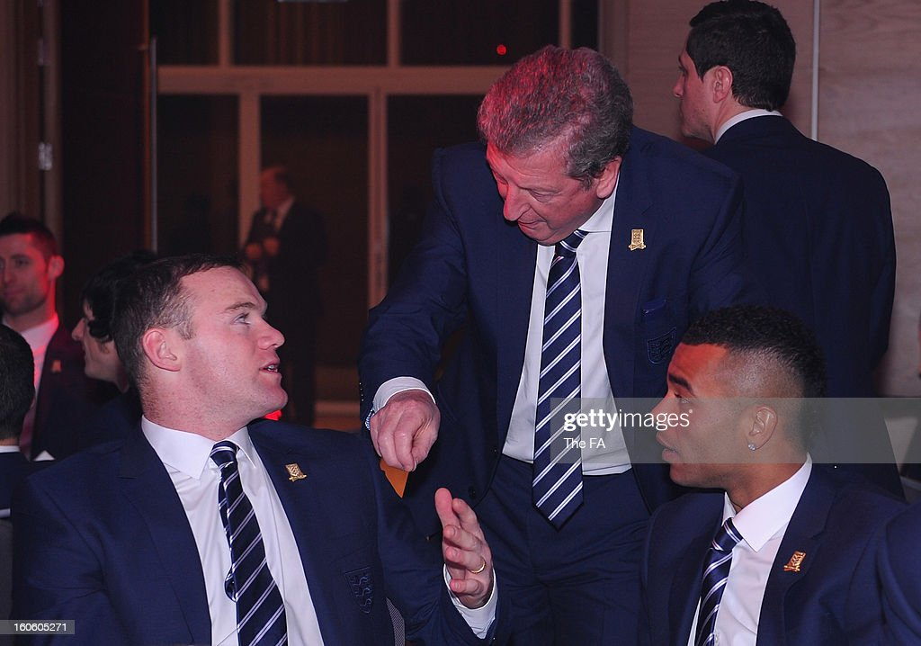 In this handout image provided by The FA, England manager Roy Hodgson talks to Wayne Rooney and Ashley Cole during the FA England Awards 2013 at St. George's Park on February 3, 2013 in Burton-upon-Trent, England.