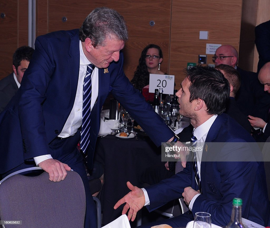 In this handout image provided by The FA, England manager Roy Hodgson talks to Frank Lampard during the FA England Awards 2013 at St. George's Park on February 3, 2013 in Burton-upon-Trent, England.