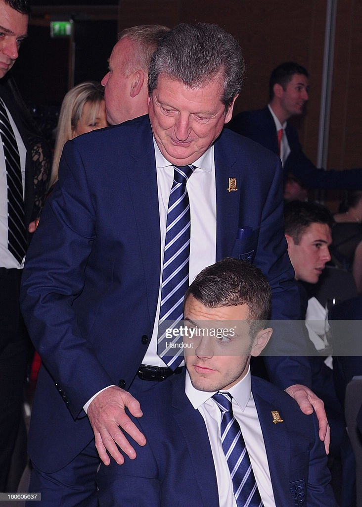 In this handout image provided by The FA, England manager Roy Hodgson talks to Jack Wilshere during the FA England Awards 2013 at St. George's Park on February 3, 2013 in Burton-upon-Trent, England.
