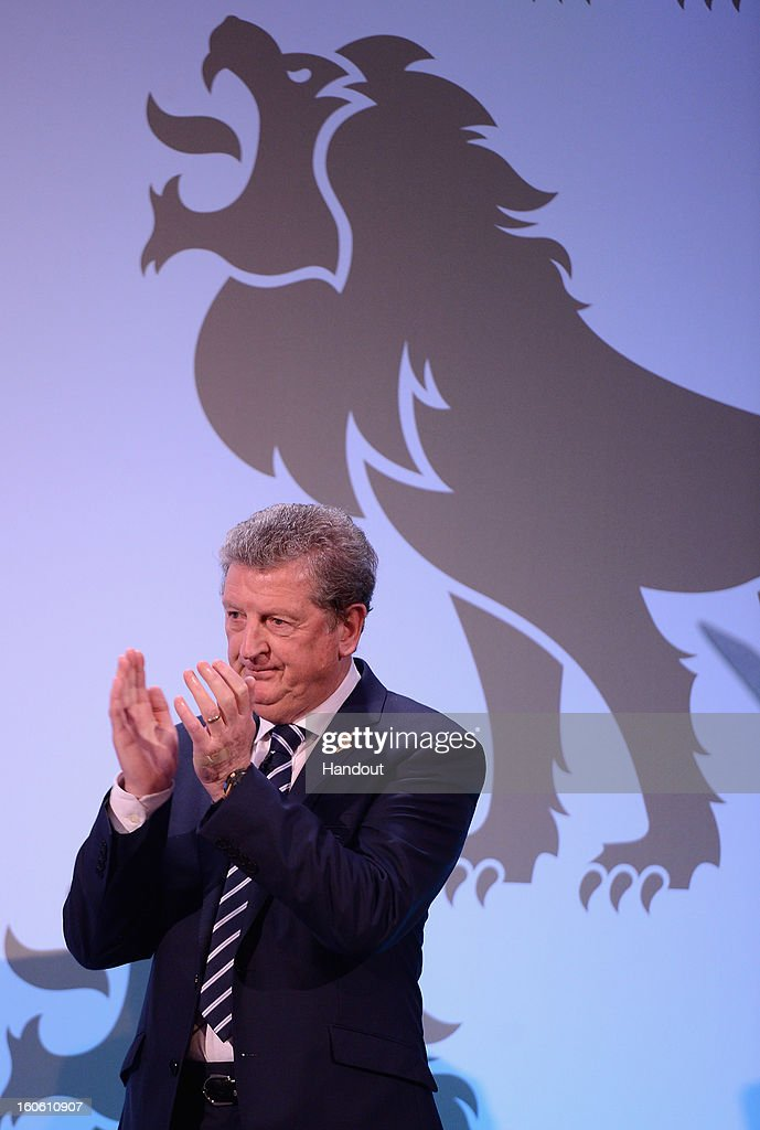 In this handout image provided by The FA, England manager Roy Hodgson applauds as Steven Gerrard receives the Senior Men's Player of the Year award during the FA England Awards 2013 at St. George's Park on February 3, 2013 in Burton-upon-Trent, England.