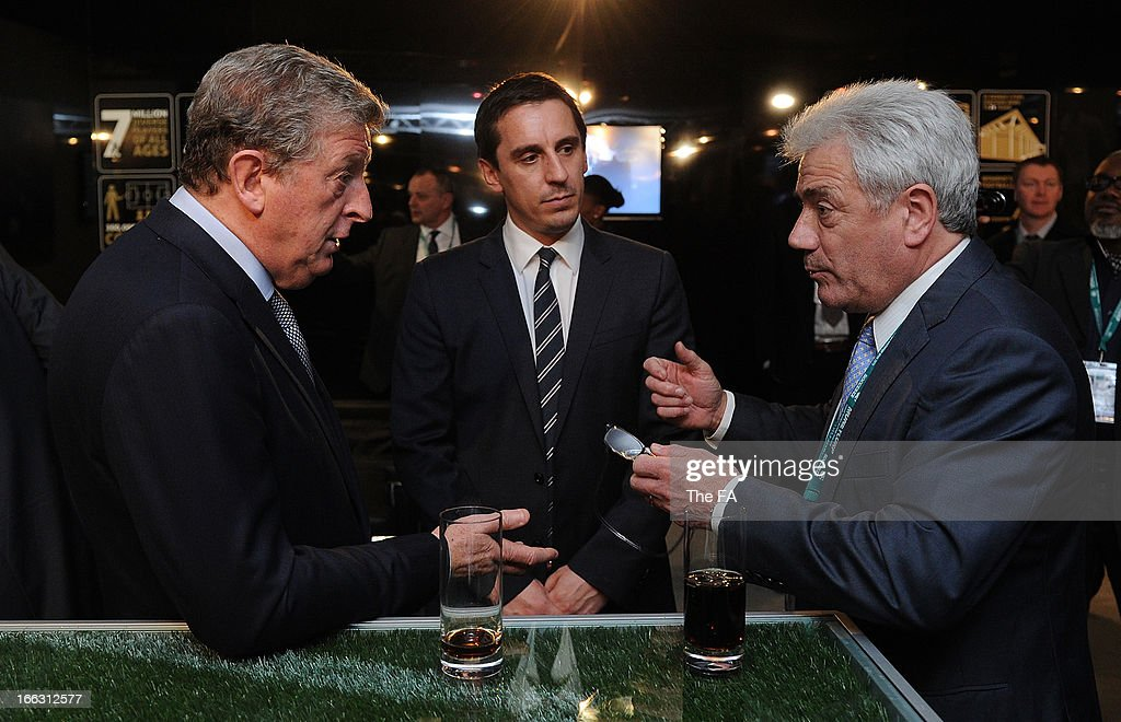 In this handout image provided by The FA, England manager Roy Hodgson speaks with Kevin Keegan as Gary Neville looks on in the FA150 lounge during the Soccerex European Forum Conference Programme in Manchester on April 11, 2013 in Manchester England.