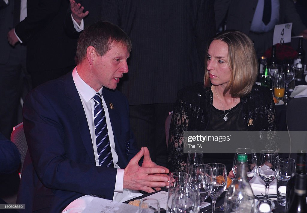 In this handout image provided by The FA, England under 21 manager Stuart Pearce talks to Faye White during the FA England Awards 2013 at St. George's Park on February 3, 2013 in Burton-upon-Trent, England.
