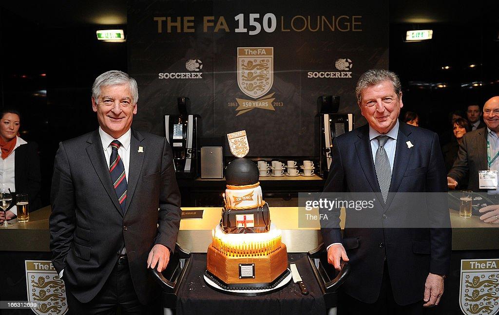 In this handout image provided by The FA, FA chairman David Bernstein and England manager Roy Hodgon pose with a birthday cake celebrating the 150th anniversary of The FA in the FA150 lounge during the Soccerex European Forum Conference Programme in Manchester on April 11, 2013 in Manchester England.