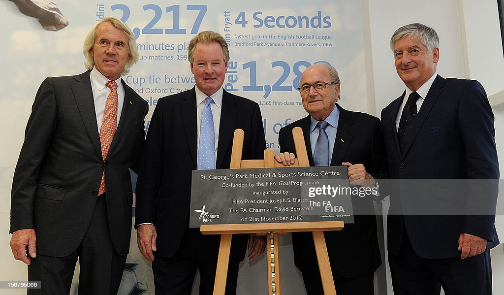 In this handout image provided by The FA, (L-R) FIFA Medical Chief Jiri Dvorak, Chairman of St Georges Park David Sheepshanks, FIFA President Joseph S Blatter and FA chairman <a gi-track='captionPersonalityLinkClicked' href=/galleries/search?phrase=David+Bernstein&family=editorial&specificpeople=6425521 ng-click='$event.stopPropagation()'>David Bernstein</a> unveil a plaque inaugurating the Medical and Sports Science Centre at St Georges Park on November 21, 2012 in Burton-upon-Trent, England.