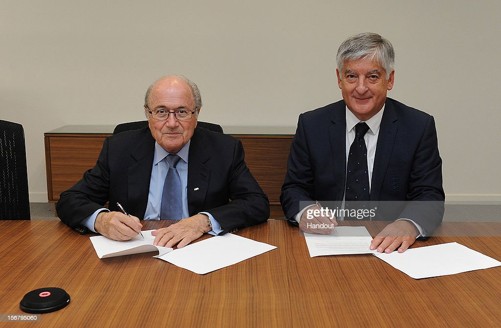 In this handout image provided by The FA, FIFA President Joseph S Blatter and FA chairman <a gi-track='captionPersonalityLinkClicked' href=/galleries/search?phrase=David+Bernstein&family=editorial&specificpeople=6425521 ng-click='$event.stopPropagation()'>David Bernstein</a> jointly sign a Memorandum of Understanding at St Georges Park on November 21, 2012 in Burton-upon-Trent, England.