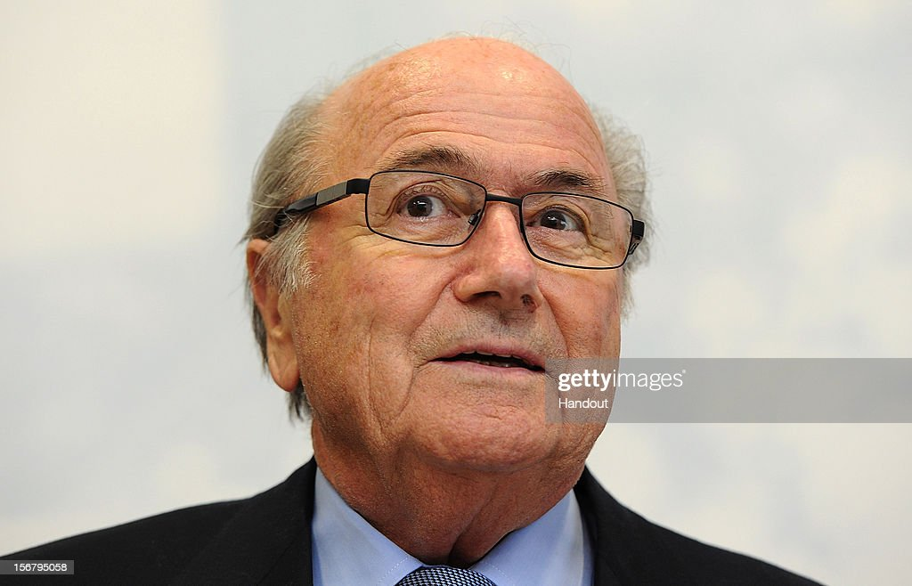 In this handout image provided by The FA, FIFA President Joseph S Blatter looks on during a visit to St Georges Park on November 21, 2012 in Burton-upon-Trent, England.