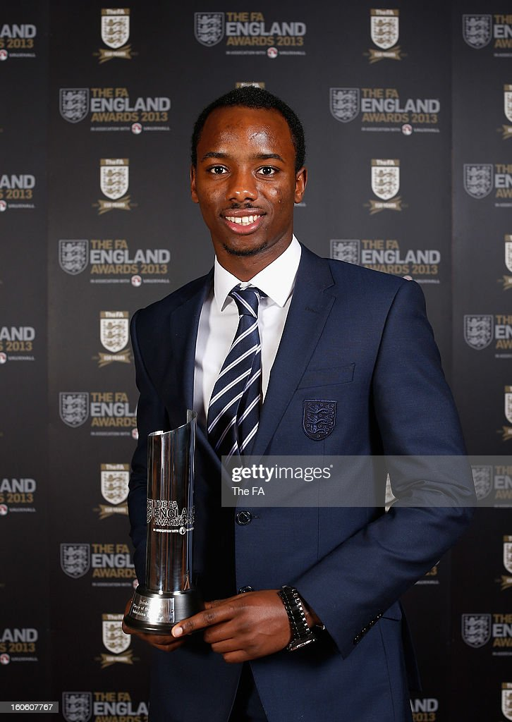 In this handout image provided by The FA, Imbrahima Diallo poses with the Disability Player of the Year award during the FA England Awards 2013 at St. George's Park on February 3, 2013 in Burton-upon-Trent, England.