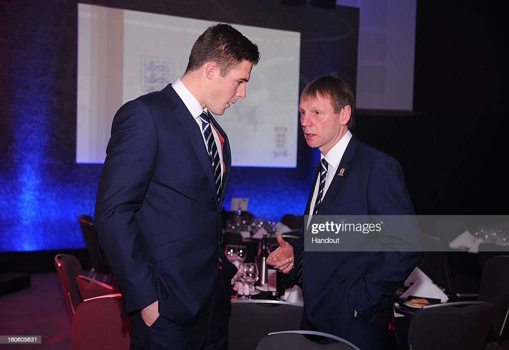 In this handout image provided by The FA, Jack Butland (L) talks to England under 21 manager Stuart Pearce during the FA England Awards 2013 at St. George's Park on February 3, 2013 in Burton-upon-Trent, England.