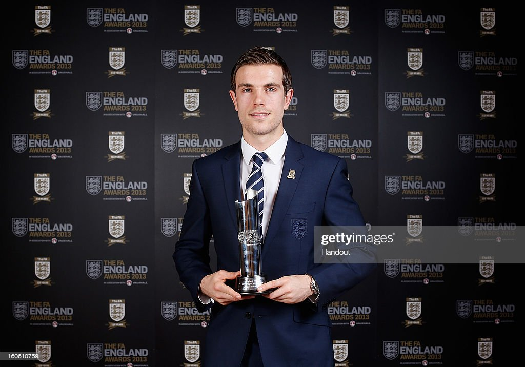 In this handout image provided by The FA, Jordan Henderson poses with the Men's Under 21 Player of the Year award during the FA England Awards 2013 at St. George's Park on February 3, 2013 in Burton-upon-Trent, England.