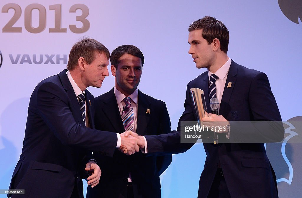 In this handout image provided by The FA, Jordan Henderson receives the Men's Under 21 Player of the Year award from Stuart Pearce (L) and Michael Owen during the FA England Awards 2013 at St. George's Park on February 3, 2013 in Burton-upon-Trent, England.