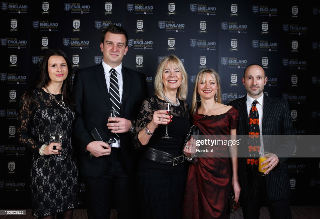 In this handout image provided by The FA, (L-R) Kelly, Ben and Linda Woolnough pose with Emma and Robin Catto during the FA England Awards 2013 at St. George's Park on February 3, 2013 in Burton-upon-Trent, England.