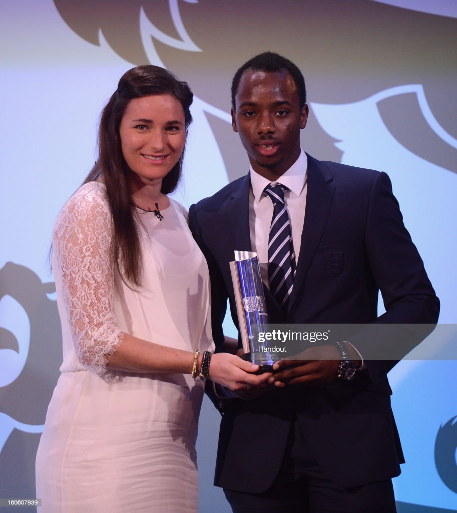 In this handout image provided by The FA, Paralympian Sarah Storey poses with Imbrahima Diallo winner of the Disability Player of the Year award during the FA England Awards 2013 at St. George's Park on February 3, 2013 in Burton-upon-Trent, England.