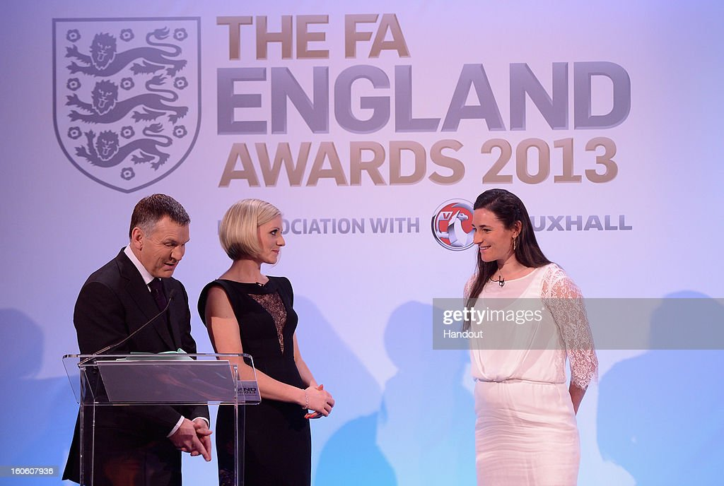 In this handout image provided by The FA, presenters Ray Stubbs and Rebecca Lowe talk to Paralympian Sarah Storey during the FA England Awards 2013 at St. George's Park on February 3, 2013 in Burton-upon-Trent, England.
