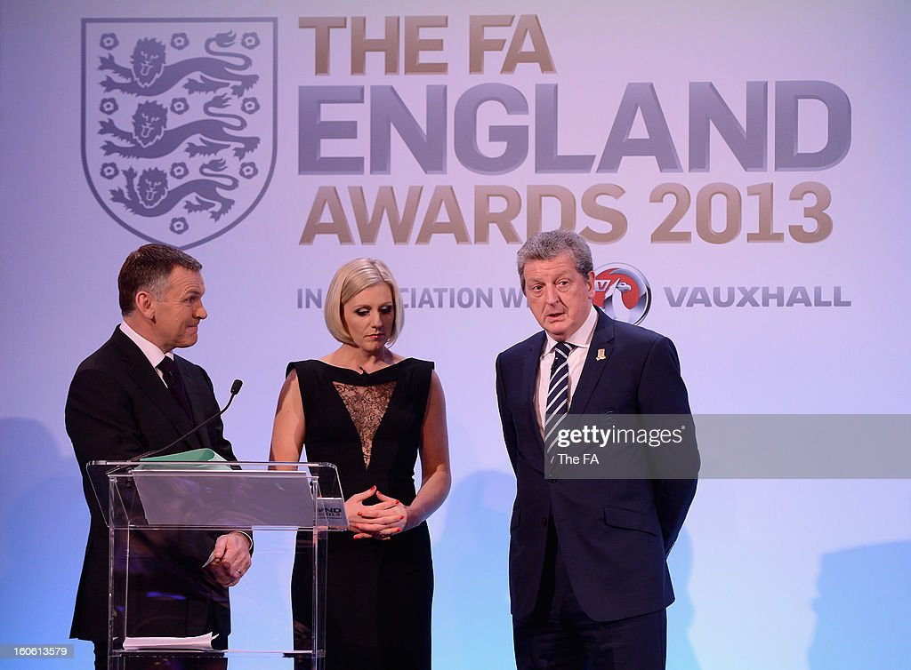 In this handout image provided by The FA, presenters Ray Stubbs and Rebecca Lowe talk to England manager Roy Hodgson during the FA England Awards 2013 at St. George's Park on February 3, 2013 in Burton-upon-Trent, England.
