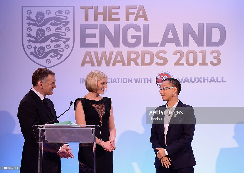 In this handout image provided by The FA, presenters Ray Stubbs and Rebecca Lowe talk to England Women's manager Hope Powell during the FA England Awards 2013 at St. George's Park on February 3, 2013 in Burton-upon-Trent, England.
