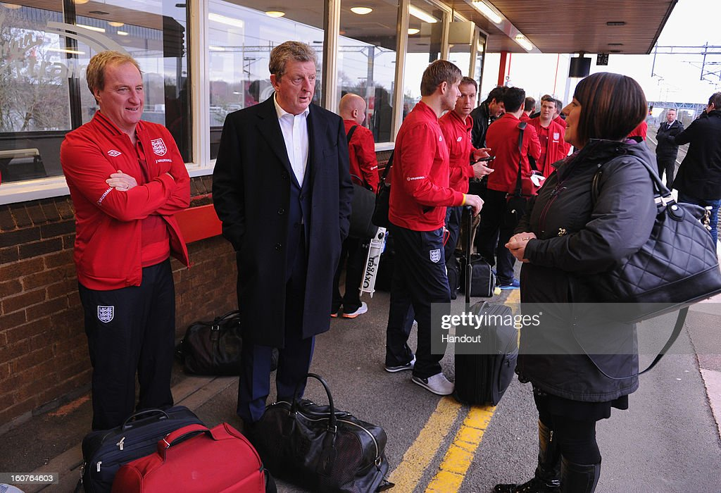 In this handout image provided by The FA, Roy Hodgson of England waits for a train as the England squad travel to London on February 5, 2013 in Birmingham England.