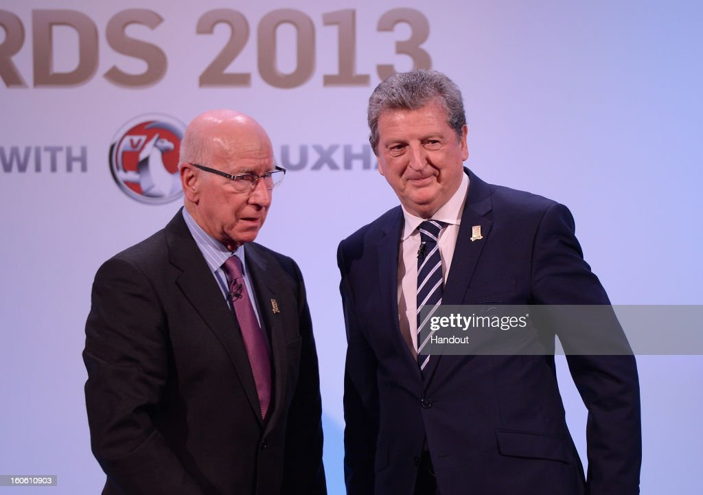 In this handout image provided by The FA, Sir Bobby Charlton (L) and England manager Roy Hodgson appear on stage during the FA England Awards 2013 at St. George's Park on February 3, 2013 in Burton-upon-Trent, England.
