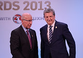 In this handout image provided by The FA Sir Bobby Charlton and England manager Roy Hodgson appear on stage during the FA England Awards 2013 at St...