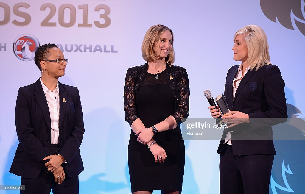 In this handout image provided by The FA, Stephanie Houghton (R) receives the Senior Women's Player of the Year award from Faye White and England Women's manager Hope Powell (L) during the FA England Awards 2013 at St. George's Park on February 3, 2013 in Burton-upon-Trent, England.