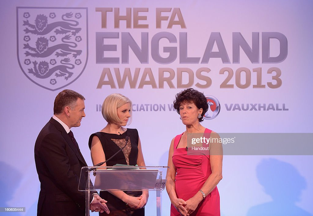 In this handout image provided by The FA, Stephanie Moore (R) talks to presenters Ray Stubbs and Rebecca Lowe during the FA England Awards 2013 at St. George's Park on February 3, 2013 in Burton-upon-Trent, England.