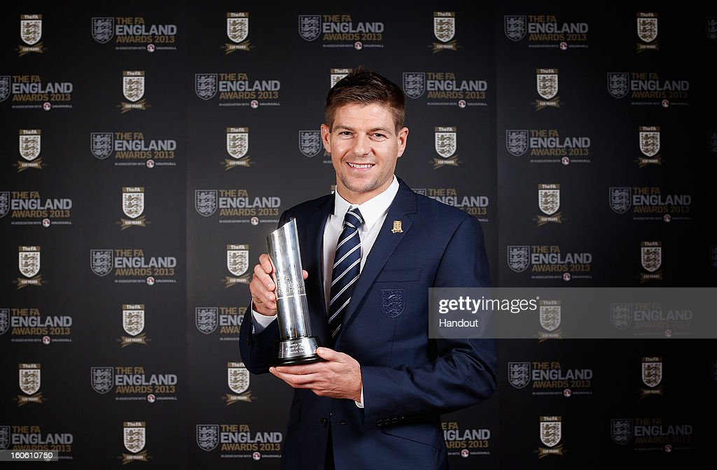 In this handout image provided by The FA, Steven Gerrard poses with the Senior Men's Player of the Year award during the FA England Awards 2013 at St. George's Park on February 3, 2013 in Burton-upon-Trent, England.
