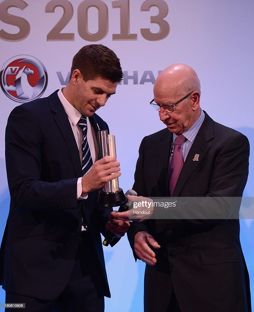 In this handout image provided by The FA, Steven Gerrard receives the Senior Men's Player of the Year award from Sir Bobby Charlton during the FA England Awards 2013 at St. George's Park on February 3, 2013 in Burton-upon-Trent, England.