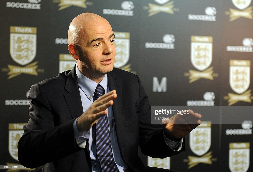 In this handout image provided by The FA, UEFA general secretary <a gi-track='captionPersonalityLinkClicked' href=/galleries/search?phrase=Gianni+Infantino&family=editorial&specificpeople=5637052 ng-click='$event.stopPropagation()'>Gianni Infantino</a> speaks to the media in the FA150 lounge during the Soccerex European Forum Conference Programme in Manchester on April 10, 2013 in Manchester England.