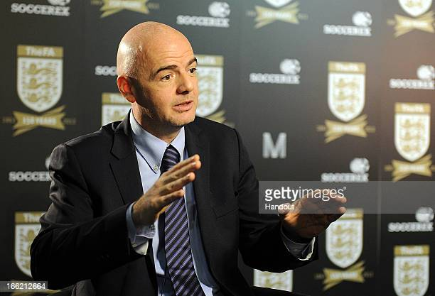 In this handout image provided by The FA UEFA general secretary Gianni Infantino speaks to the media in the FA150 lounge during the Soccerex European...