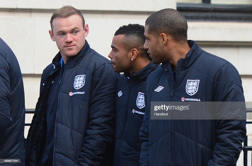 In this handout image provided by The FA, <a gi-track='captionPersonalityLinkClicked' href=/galleries/search?phrase=Wayne+Rooney&family=editorial&specificpeople=157598 ng-click='$event.stopPropagation()'>Wayne Rooney</a>, <a gi-track='captionPersonalityLinkClicked' href=/galleries/search?phrase=Ashley+Cole&family=editorial&specificpeople=201831 ng-click='$event.stopPropagation()'>Ashley Cole</a> and <a gi-track='captionPersonalityLinkClicked' href=/galleries/search?phrase=Glen+Johnson&family=editorial&specificpeople=209192 ng-click='$event.stopPropagation()'>Glen Johnson</a> chat as the England squad go for a walk around Mayfair in London ahead of the game against Brazil on February 6, 2013 in London England.
