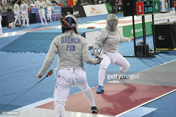 In this handout image provided by the FIE Eileen Grench of Panama and Cho JuYeon of Korea compete during the individual Women's Sabre match during...