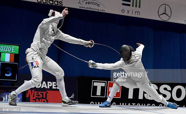 In this handout image provided by the FIE Gauthier Grumier of France and Enrico Garozzo of Italy compete during the individual men's epee final on...
