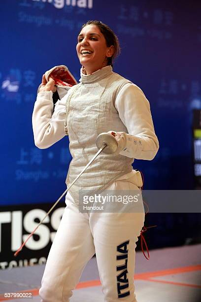 In this handout image provided by the FIE Italy's Arianna Errigo wins the final of the women's foil fencing grand prix on June 4 2016 in Shanghai...