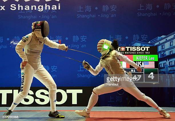 In this handout image provided by the FIE USA's Lee Kiefer fences against Italy's Arianna Errigo in the final of the women's foil fencing grand prix...