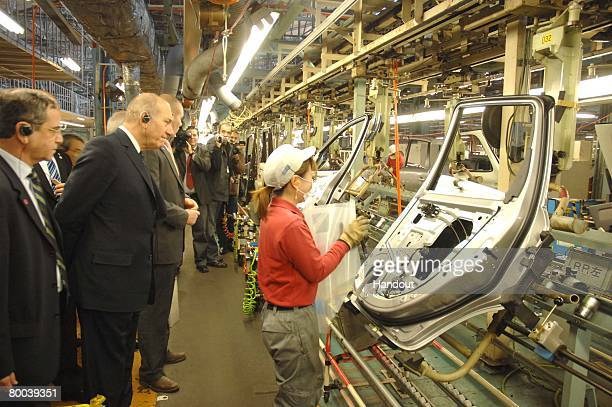 In this handout image provided by the GPO Israeli Prime Minister Eud Olmert tours a Nissan automobile manufacturing plant that is producing electric...