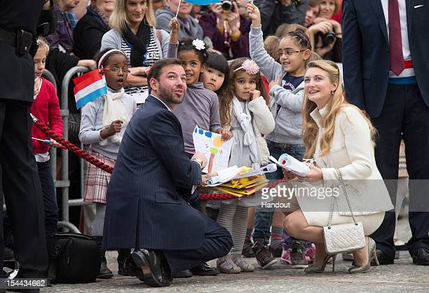In this handout image provided by the GrandDucal Court of Luxembourg Prince Guillaume of Luxembourg and Countess Stephanie de Lannoy talk with...
