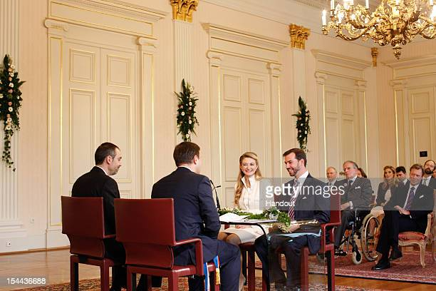 In this handout image provided by the GrandDucal Court of Luxembourg Mayor of Luxembourg Xavier Bettel speaks with Countess Stephanie de Lannoy and...