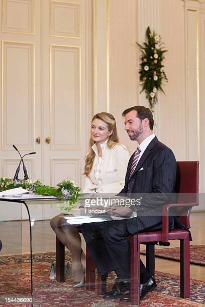 In this handout image provided by the GrandDucal Court of Luxembourg Countess Stephanie de Lannoy and Prince Guillaume of Luxembourg attend their...