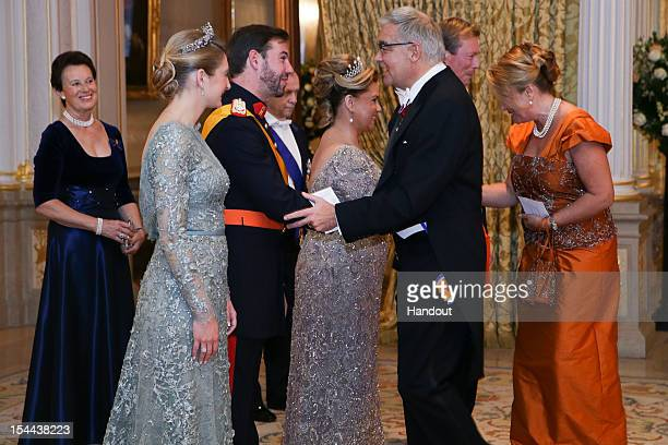 In this handout image provided by the GrandDucal Court of Luxembourg Countess Stephanie de Lannoy Prince Guillaume Of Luxembourg greet Luxembourg's...
