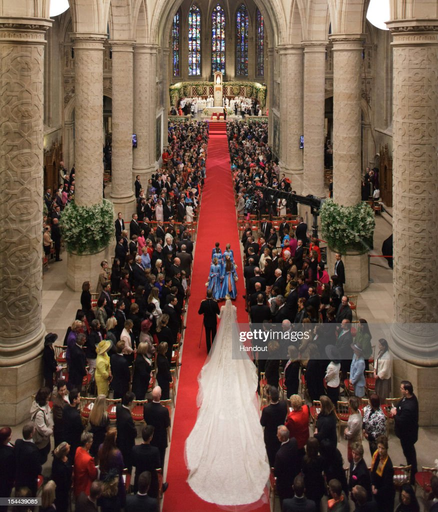 In this handout image provided by the Grand-Ducal Court of Luxembourg, Princess Stephanie of Luxembourg walks down the aisle with her brother Count Jehan de Lannoy during the wedding ceremony of Prince Guillaume Of Luxembourg and Stephanie de Lannoy at the Cathedral of our Lady of Luxembourg on October 20, 2012 in Luxembourg, Luxembourg. The 30-year old hereditary Grand Duke of Luxembourg is the last hereditary Prince in Europe to get married, marrying his 28-year old Belgian Countess bride in a lavish 2-day ceremony.