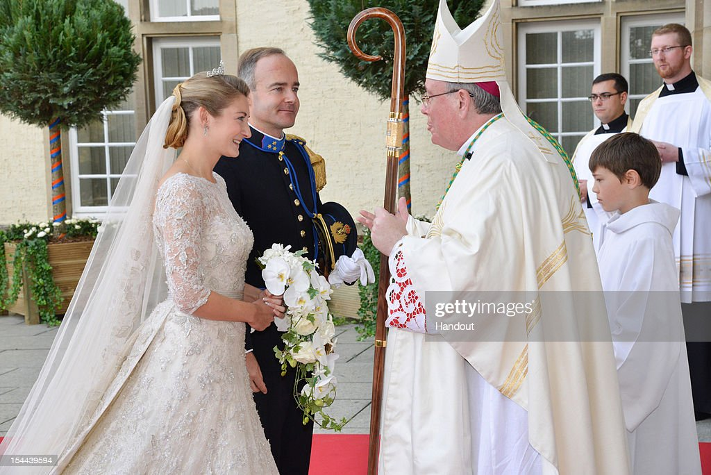 In this handout image provided by the Grand-Ducal Court of Luxembourg, Stephanie de Lannoy and her brother Count Jehan de Lannoy greet Most Reverend Jean-Claude Hollerich, Archbishop of Luxembourg as they arrive to attend the wedding ceremony of Prince Guillaume Of Luxembourg and Stephanie de Lannoy at the Cathedral of our Lady of Luxembourg on October 20, 2012 in Luxembourg, Luxembourg. The 30-year old hereditary Grand Duke of Luxembourg is the last hereditary Prince in Europe to get married, marrying his 28-year old Belgian Countess bride in a lavish 2-day ceremony.