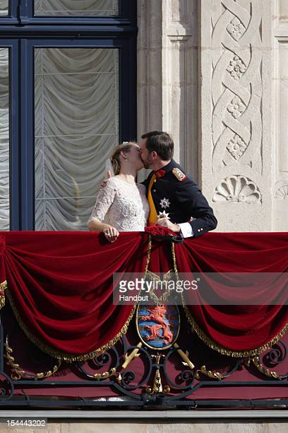 In this handout image provided by the GrandDucal Court of Luxembourg Princess Stephanie of Luxembourg and Prince Guillaume of Luxembourg kiss on the...