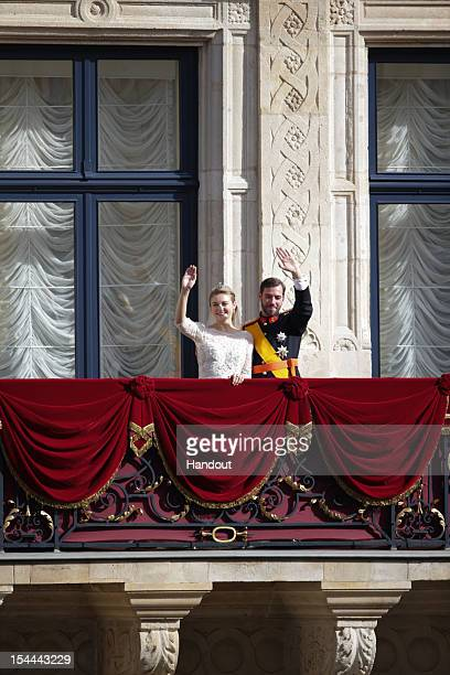 In this handout image provided by the GrandDucal Court of Luxembourg Princess Stephanie of Luxembourg and Prince Guillaume of Luxembourg wave from...