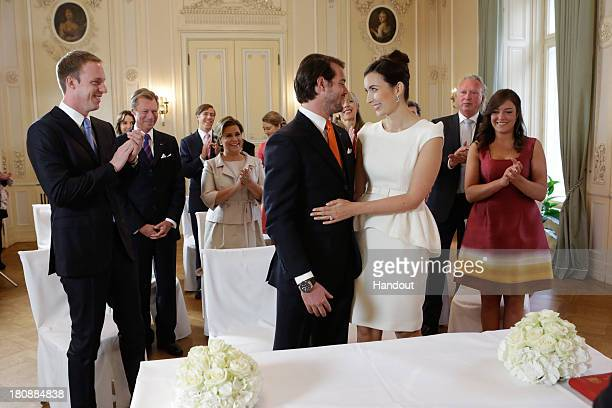 In this handout image provided by the GrandDucal Court of Luxembourg Prince Felix Of Luxembourg Claire Lademacher and their respective family attend...