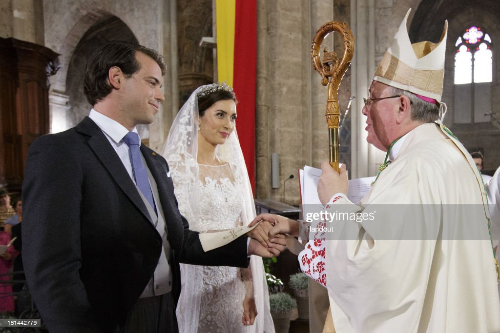 In this handout image provided by the Grand-Ducal Court of Luxembourg, Prince Felix Of Luxembourg and Princess Claire Of Luxembourg are standing in front of Most Reverend Jean-Claude Hollerich, Archbishop of Luxembourg during their wedding ceremony at the Basilique Sainte Marie-Madeleine on September 21, 2013 in Saint-Maximin-La-Sainte-Baume, France. ©Grand-Ducal Court/Guy Wolff/All rights reserved.
