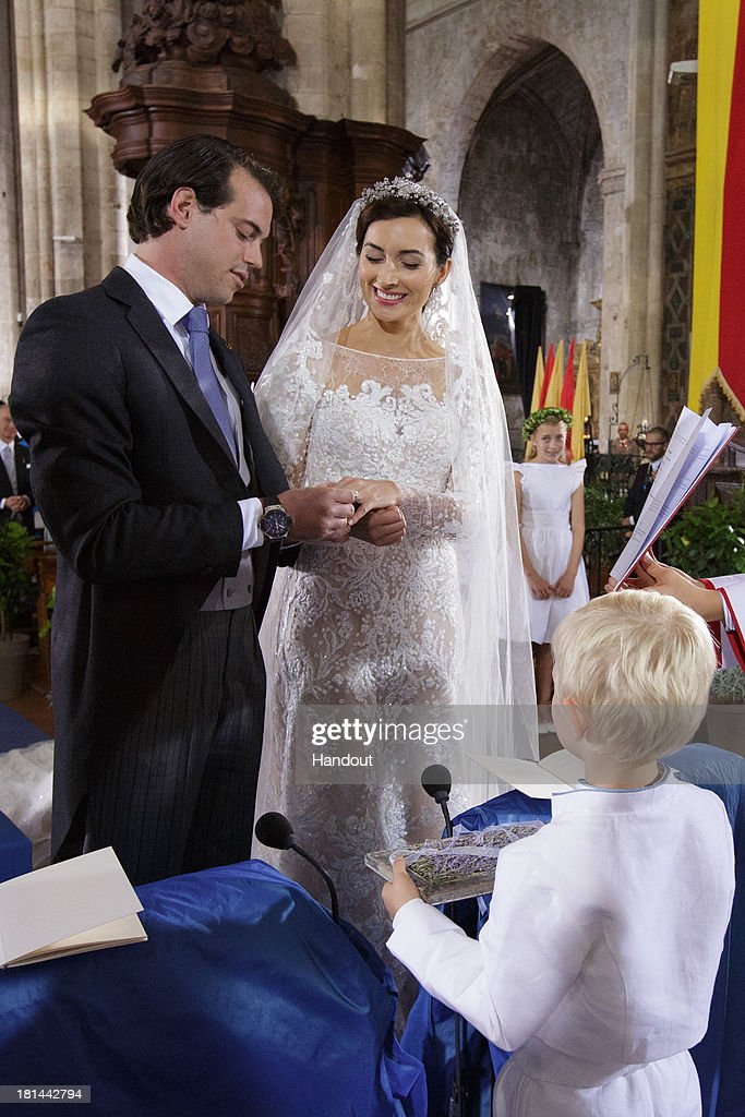 In this handout image provided by the Grand-Ducal Court of Luxembourg, Prince Felix Of Luxembourg, Princess Claire Of Luxembourg and Prince Noah Of Luxembourg are seen during the wedding ceremony of Prince Felix Of Luxembourg and Princess Claire Of Luxembourg at the Basilique Sainte Marie-Madeleine on September 21, 2013 in Saint-Maximin-La-Sainte-Baume, France. ©Grand-Ducal Court/Guy Wolff/All rights reserved.