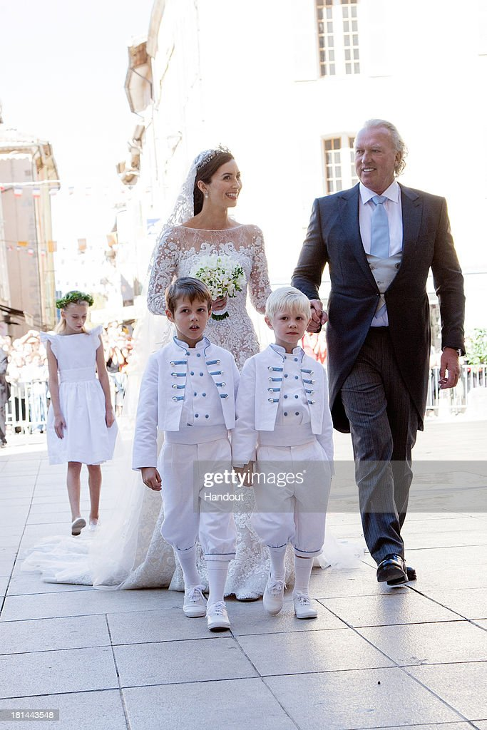 In this handout image provided by the Grand-Ducal Court of Luxembourg, Princess Claire Of Luxembourg, her father Hartmut Lademacher, Prince Noah Of Luxembourg and Prince Gabriel Of Luxembourg arrive at the wedding ceremony of Prince Felix Of Luxembourg and Princess Claire Of Luxembourg at the Basilique Sainte Marie-Madeleine on September 21, 2013 in Saint-Maximin-La-Sainte-Baume, France. ©Grand-Ducal Court/Eric Chenal/All rights reserved.