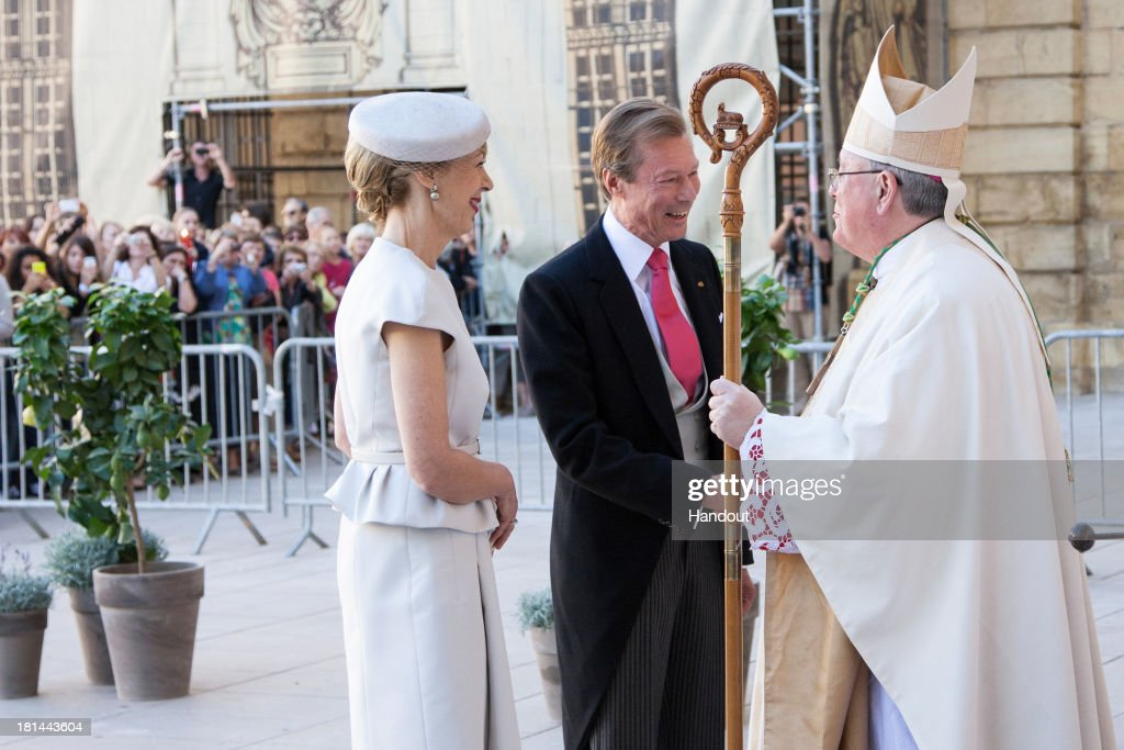 In this handout image provided by the Grand-Ducal Court of Luxembourg, Gabriele Lademacher and Grand Duke Henri are greeted by Most Reverend Jean-Claude Hollerich, Archbishop of Luxembourg at the wedding ceremony of Prince Felix Of Luxembourg and Princess Claire Of Luxembourg at the Basilique Sainte Marie-Madeleine on September 21, 2013 in Saint-Maximin-La-Sainte-Baume, France. ©Grand-Ducal Court/Eric Chenal/All rights reserved.