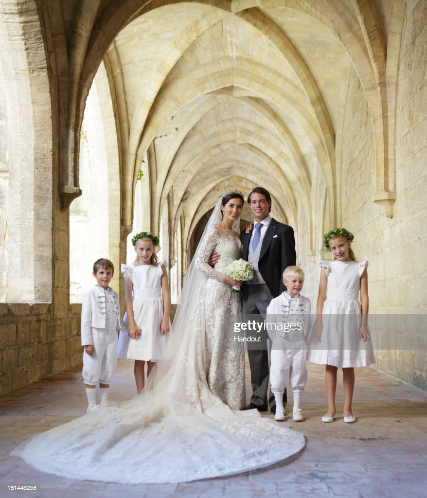 In this handout image provided by the Grand-Ducal Court of Luxembourg, Prince Felix Of Luxembourg and Princess Claire Of Luxembourg pose with Prince Noah Of Luxembourg, Prince Gabriel Of Luxembourg, Flora Doimi de Frankopan and Katharina Doimi de Frankopan for an official photo inside the Couvent Royal De Saint-Maximin after their wedding ceremony at the Basilique Sainte Marie-Madeleine on September 21, 2013 in Saint-Maximin-La-Sainte-Baume, France. ©Grand-Ducal Court/Guy Wolff/All rights reserved.