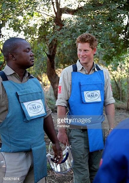 In this handout image provided by The HALO Trust Prince Harry is seen with deminers from The HALO Trust a British charity dedicated to removal of...