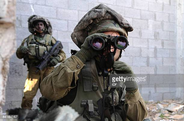 In this handout image provided by the IDF Israeli troops carry out ground manoevres on January 6 2009 in Gaza The Israeli army announced that four of...